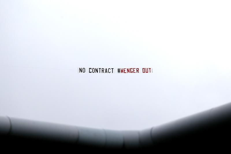 The fans even hired a plane to get their message about Wenger cross