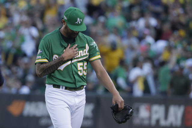 Oakland Athletics pitcher Sean Manaea (55) walks off the mound after retiring the Tampa Bay Rays during the first inning of an American League wild-card baseball game in Oakland, Calif., Wednesday, Oct. 2, 2019. (AP Photo/Jeff Chiu)