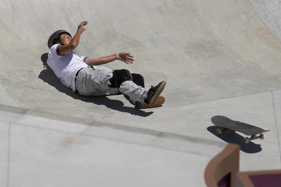 Ayumu Hirano of Japan falls while competing in the men's park skateboarding prelims at the 2020 Summer Olympics, Thursday, Aug. 5, 2021, in Tokyo, Japan. (AP Photo/Ben Curtis)