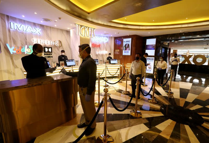 Preparations ahead of the reopening of movie theaters, in Mumbai