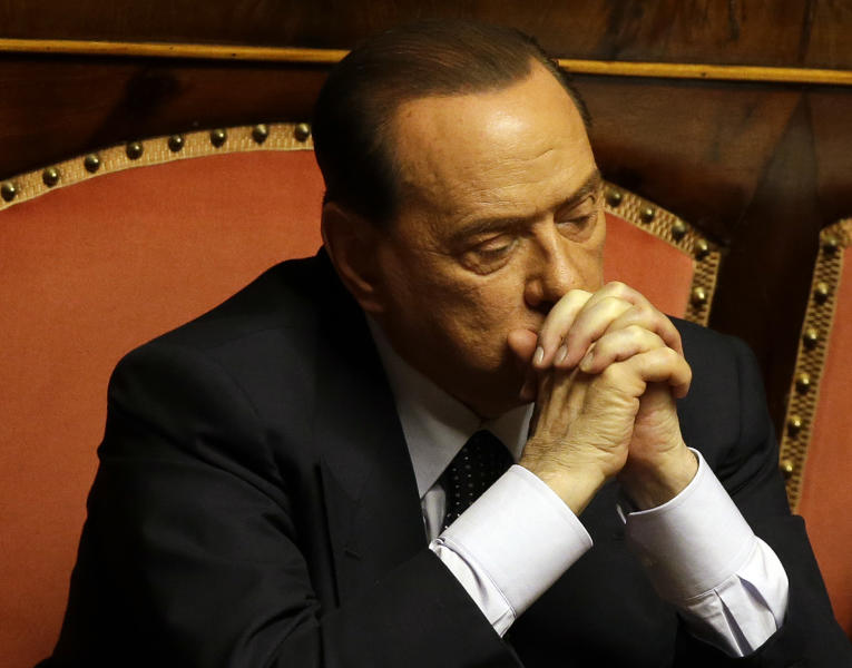 In this photo taken on Friday, July 19, 2013 Silvio Berlusconi attends a voting session at the Senate in Rome. Silvio Berlusconi, the billionaire media baron and former premier, sometimes quipped that he was running out of money after two decade of steadily paying millions of euros (dollars) to a stable of Italy's leading lawyers to defend him in a raft of criminal cases. The legal team earned its keep, either eventually scoring acquittals or devising strategies that helped stretch out the court calendar for so long the cases died when statutes of limitations ran out. But this time, they failed to deliver him from final judgment day for a guilty verdict that arrives Tuesday at Italy's highest court, and Berlusconi's no longer joking. (AP Photo/Gregorio Borgia)