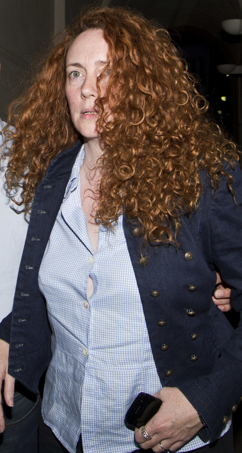 FILE - Former Chief executive of News International, Rebekah Brooks leaves a hotel in central London, in this Sunday, July 10, 2011 file photo.  Sky television sources reported on Sunday July 17 2011 that Brookes had been arrested by police investigating a phone hacking and corruption scandal that has engulfed Rupert Murdoch's British media company. Scotland Yard confirmed that a 43 year old woman had been arrested. (AP Photo/Sang Tan, file)