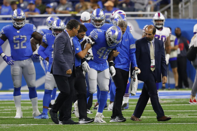 Detroit Lions middle linebacker Jarrad Davis (40) is helped off the field by medical staff during Friday's game. (AP)