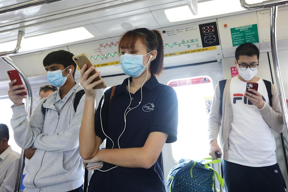 SINGAPORE - JANUARY 30:  Passengers are seen wearing a protective mask on a train ride on January 30, 2020 in Singapore. Singapore has confirmed ten cases of the deadly coronavirus, which emerged last month in the city of Wuhan in China. The virus has since spread to 21 countries with 170 deaths reported as of January 30.  (Photo by Suhaimi Abdullah/Getty Images)