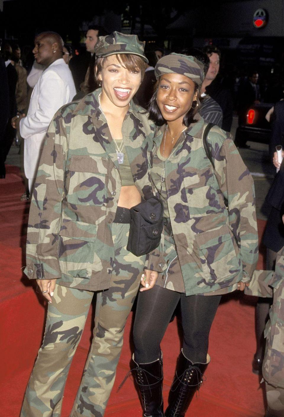 <p>Tisha Campbell and Tichina Arnold turned up in camo. </p>