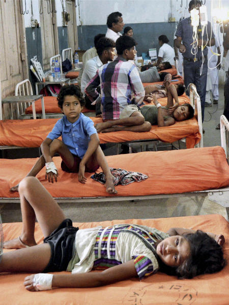 Indian children who fell ill after eating the daily free lunch at a rural Indian school undergo treatment at a hospital in Patna, India, Thursday, July 18, 2013.By Thursday afternoon, 23 children between the ages of 5 and 12 had died from eating food laced with insecticide and many others had fallen ill. (AP Photo) INDIA OUT