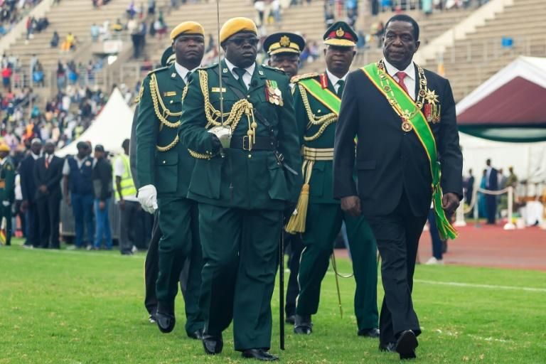 President Emmerson Mnangagwa, right, lashed out at new price hikes in Zimbabwe as the country marked its 39th independence anniversary