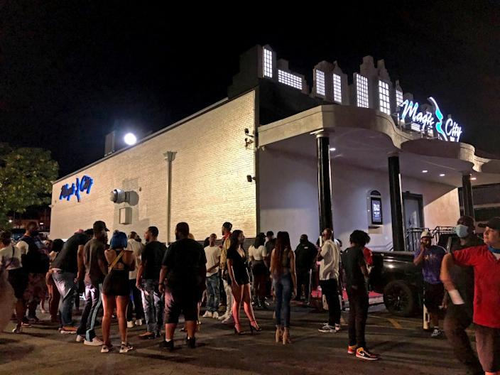 People gather outside the Magic City strip club in Atlanta