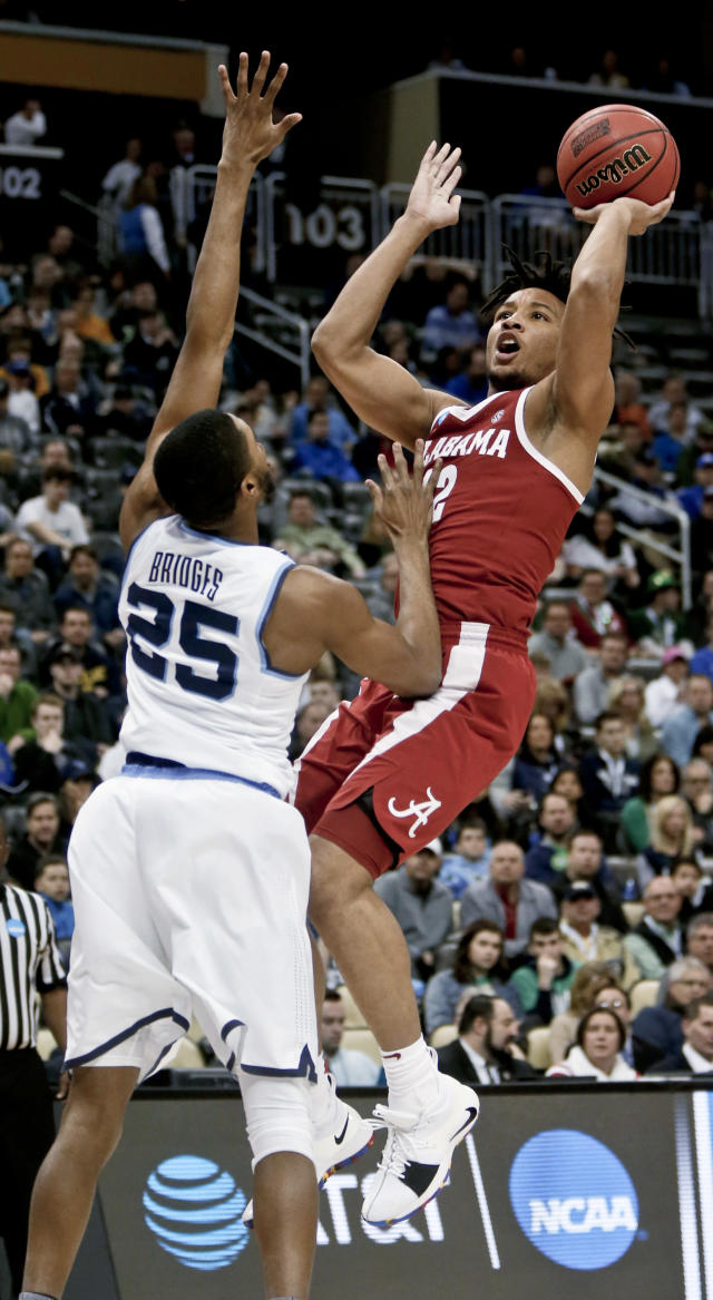 Alabama's Dazon Ingram (12) shoots over Villanova's Mikal Bridges (25) during the first half of a second-round game in the NCAA men's college basketball tournament, Saturday, March 17, 2018, in Pittsburgh. (AP Photo/Keith Srakocic)