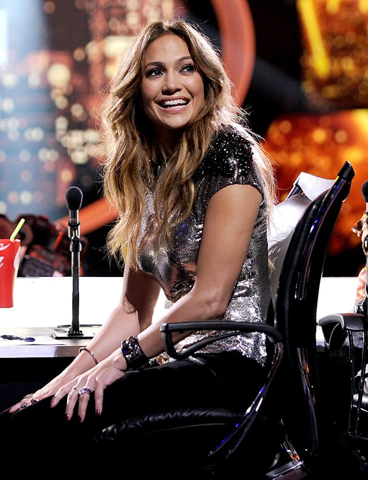 "Jennifer Lopez has fallen for ""Idol"" contestant Phillip Phillips, reveals In Touch, which notes she ""acts like a giddy schoolgirl"" around him. It's not sitting well with Casper Smart, who's now constantly at ""Idol"" to ""keep an eye"" on her and Phillips. For who has shockingly won J. Lo's heart, and why, see what her friend spills to <a target=""_blank"" href=""http://www.gossipcop.com/jennifer-lopez-phillip-phillips-hookup-flirting-hooking-up-dating-couple/"">Gossip Cop</a>."