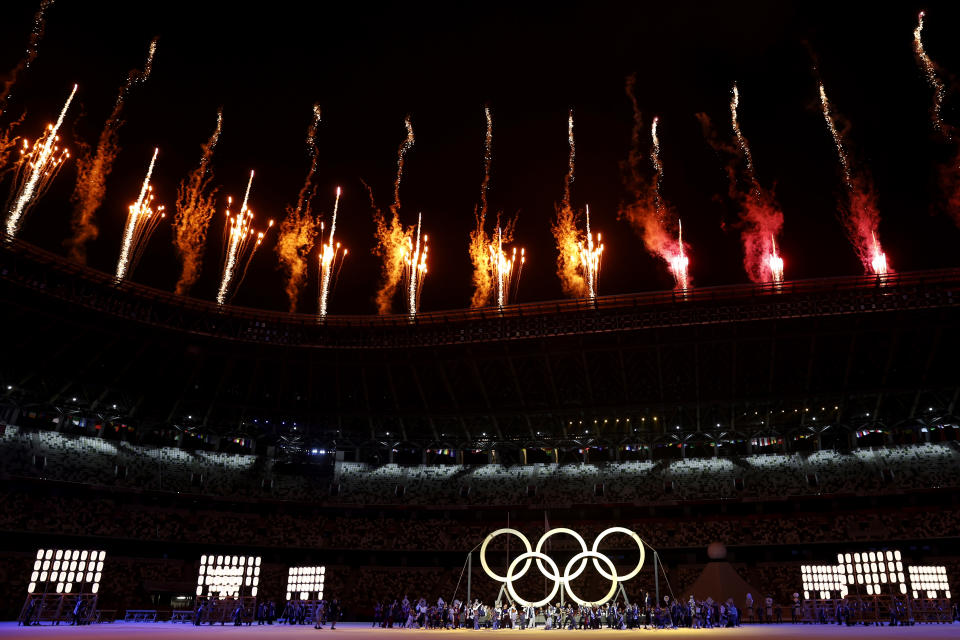 <p>TOKYO, JAPAN - JULY 23: A general view inside the stadium as fireworks go off and performers dance during the Opening Ceremony of the Tokyo 2020 Olympic Games at Olympic Stadium on July 23, 2021 in Tokyo, Japan. (Photo by Jamie Squire/Getty Images)</p>