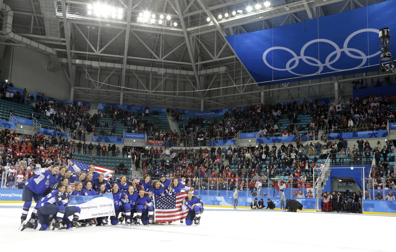 Untied States hockey team pose after beating Canada in the women's gold medal hockey game at the 2018 Winter Olympics in Gangneung, South Korea, Thursday, Feb. 22, 2018. (AP Photo/Julio Cortez)