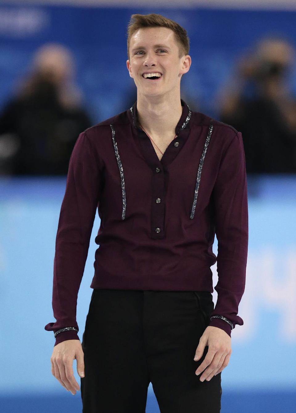 Jeremy Abbott of the United States reacts after finishing his routine in the men's short program figure skating competition at the Iceberg Skating Palace during the 2014 Winter Olympics, Thursday, Feb. 13, 2014, in Sochi, Russia. (AP Photo/Bernat Armangue)