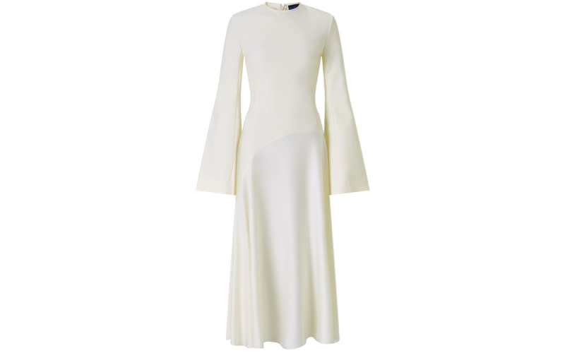"""<p>A drop waist, silk skirt and trumpet sleeves is the sartorial recipe for wedding dress success. Team with strappy shoes and a vintage veil. <em><a rel=""""nofollow noopener"""" href=""""https://www.solacelondon.com/gaia-dress-cream-7604.html"""" target=""""_blank"""" data-ylk=""""slk:Shop now"""" class=""""link rapid-noclick-resp"""">Shop now</a>.</em> </p>"""