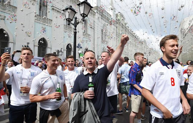 <p>England fans gather in Nikolskaya street near the Red Square in Moscow. </p>
