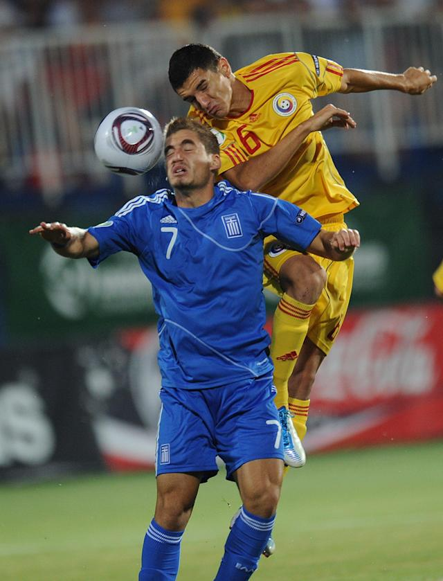 Romario Benzar (R) of Romania vies for the ball with Charis Mavrias (L) of Greece during the final football match of the UEFA European Under-19 Championship 2010/2011 in Berceni village next to Bucharest July 23, 2011. AFP PHOTO/DANIEL MIHAILESCU (Photo credit should read DANIEL MIHAILESCU/AFP/Getty Images)