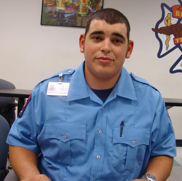 This photo provided by the City of Bryan shows firefighter Mitchel Moran, in serious but stable condition, Sunday, Feb. 17, 2013, as investigators try to determine what sparked a lodge hall fire that killed two colleagues. (AP Photo/City of Bryan)