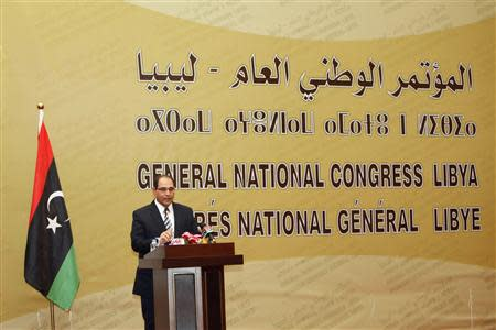 Nuri al-Abbar, head of the High National Elections Commission, speaks during a ceremony in Tripoli January 30, 2014. REUTERS/Ismail Zitouny
