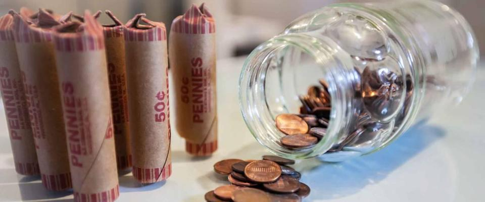 American coins in loose change and in paper rolls prepared for currency exchange at the bank.