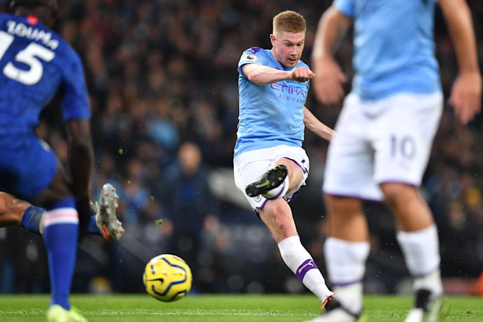 Manchester City's Belgian midfielder Kevin De Bruyne shoots to score their first goal during the English Premier League football match between Manchester City and Chelsea at the Etihad Stadium in Manchester, north west England, on November 23, 2019. (Photo by Paul ELLIS / AFP) / RESTRICTED TO EDITORIAL USE. No use with unauthorized audio, video, data, fixture lists, club/league logos or 'live' services. Online in-match use limited to 120 images. An additional 40 images may be used in extra time. No video emulation. Social media in-match use limited to 120 images. An additional 40 images may be used in extra time. No use in betting publications, games or single club/league/player publications. /  (Photo by PAUL ELLIS/AFP via Getty Images)