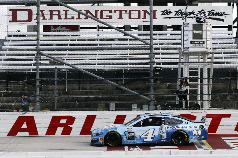 Kevin Harvick (4) crosses the finish line to win the NASCAR Cup Series auto race Sunday, May 17, 2020, in Darlington, S.C. (AP Photo/Brynn Anderson)