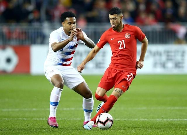 USA's Weston McKennie challenges Canada's Jonathan Osorio in their CONCACAF Nations League clash (AFP Photo/Vaughn Ridley)