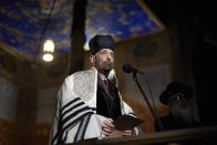 A rabbi prays during commemorative events marking the 80th anniversary of the Babi Yar massacre of Kyiv Jews perpetrated by German occupying forces in 1941 in Kyiv, Ukraine, Wednesday, Oct. 6, 2021. (Ukrainian Presidential Press Office via AP)