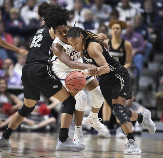 Connecticut's Christyn Williams, center, pressures Central Florida's Lawriell Wilson, right, as Central Florida's Brittney Smith, left, defends during the first half of an NCAA college basketball game in the American Athletic Conference women's tournament finals, Monday, March 11, 2019, at Mohegan Sun Arena in Uncasville, Conn. (AP Photo/Jessica Hill)