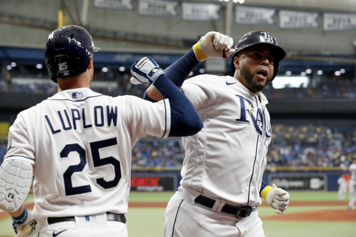 Tampa Bay Rays' Nelson Cruz, right, celebrates with teammate Jordan Luplow after hitting a home run against the Minnesota Twins during the fourth inning of a baseball game on Saturday, Sept. 4, 2021, in St. Petersburg, Fla. (AP Photo/Scott Audette)