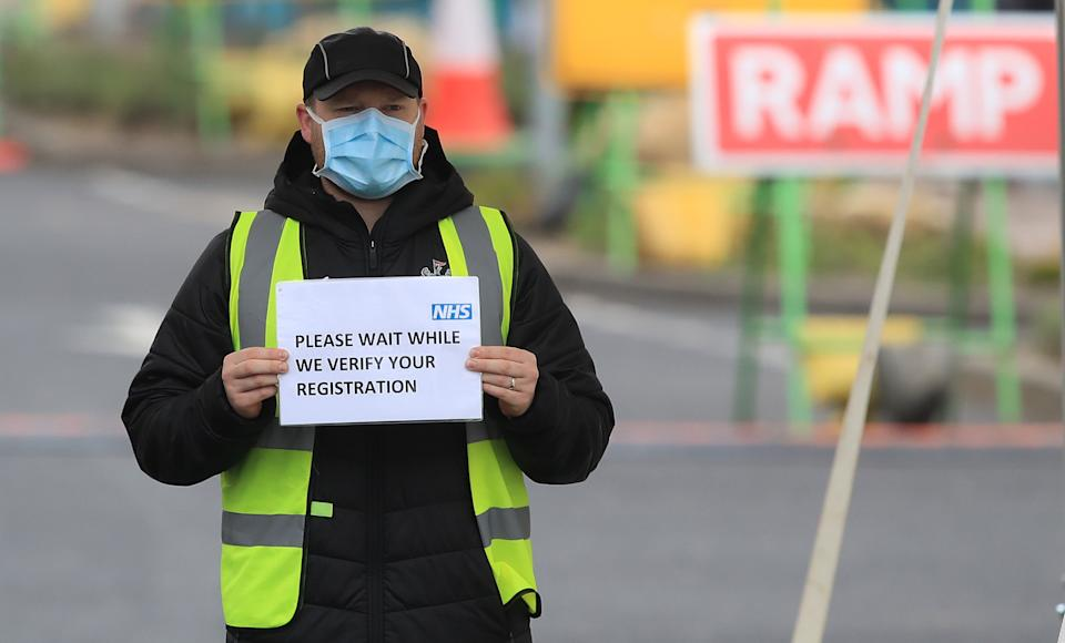 A member of staff gives directions at the coronavirus testing centre which has been set up for the testing of NHS staff at IKEA in Gateshead. (Photo by Owen Humphreys/PA Images via Getty Images)