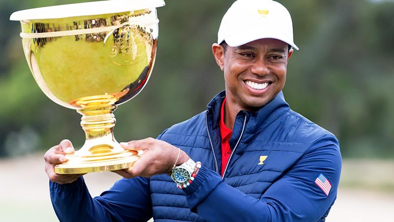 Tiger Woods, pictured here with the cup after winning The Presidents Cup.