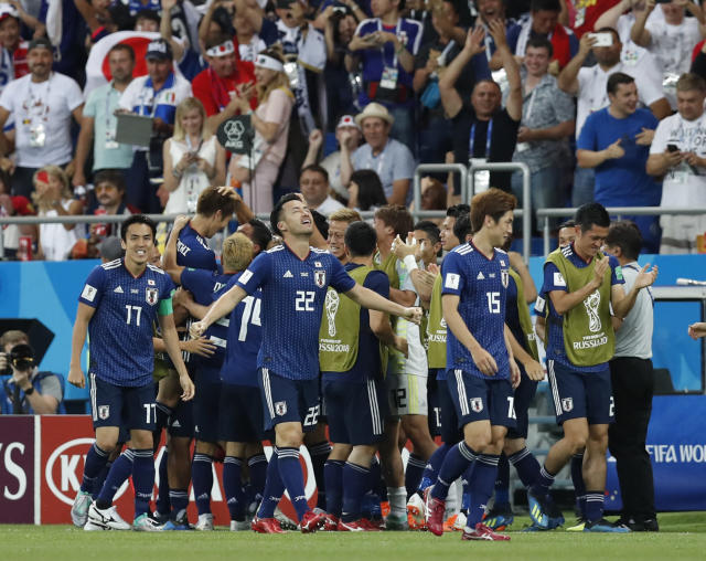 <p>Japan's players celebrate after Japan's Takashi Usami scores his side's second goal during the round of 16 match between Belgium and Japan at the 2018 soccer World Cup in the Rostov Arena, in Rostov-on-Don, Russia, Monday, July 2, 2018. (AP Photo/Rebecca Blackwell) </p>