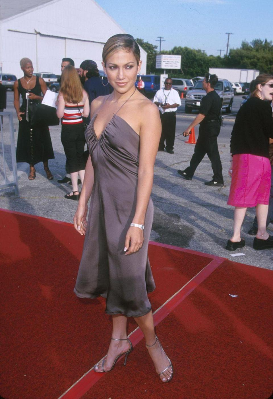 <p>The two-strap high heel is still very much around today, but it paired perfectly with the simplicity of a '90s silk slip dress—much like the one J.Lo wore to the Teen Choice Awards.</p>