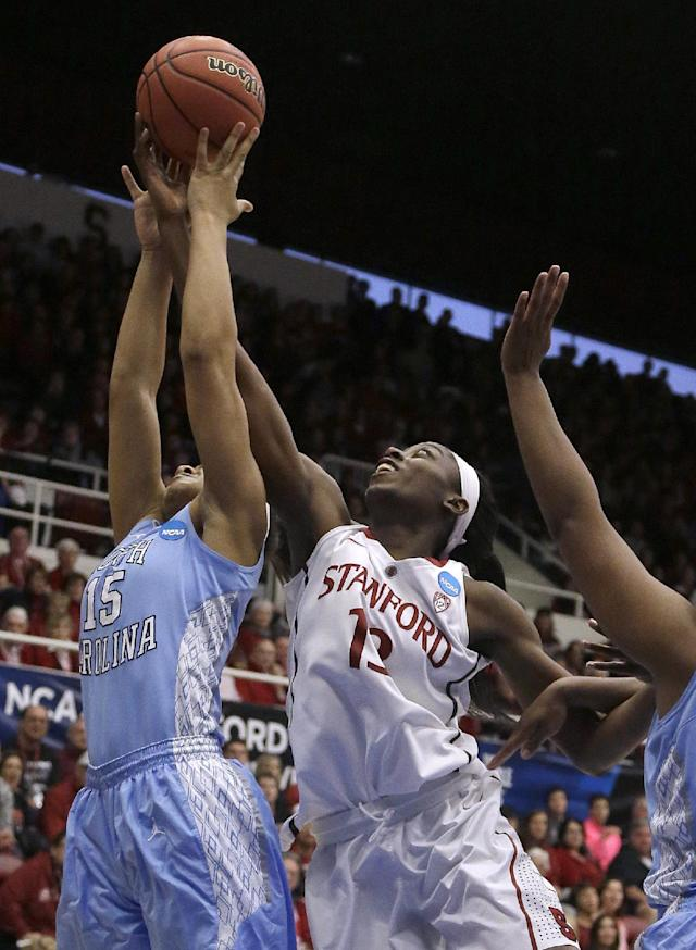 North Carolina guard Allisha Gray (15) grabs a rebound over Stanford forward Chiney Ogwumike (13) during the first half of a regional final in the NCAA women's college basketball tournament in Stanford, Calif., Tuesday, April 1, 2014. (AP Photo/Jeff Chiu)