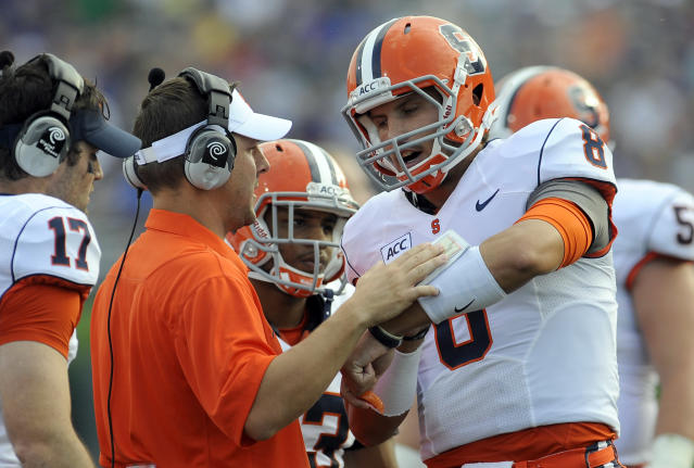 Syracuse's Drew Allen (8) talks with a coach during the first half of an NCAA college football game Saturday, Sept. 7, 2013 in Evanston, Ill. (AP Photo/Matt Marton)