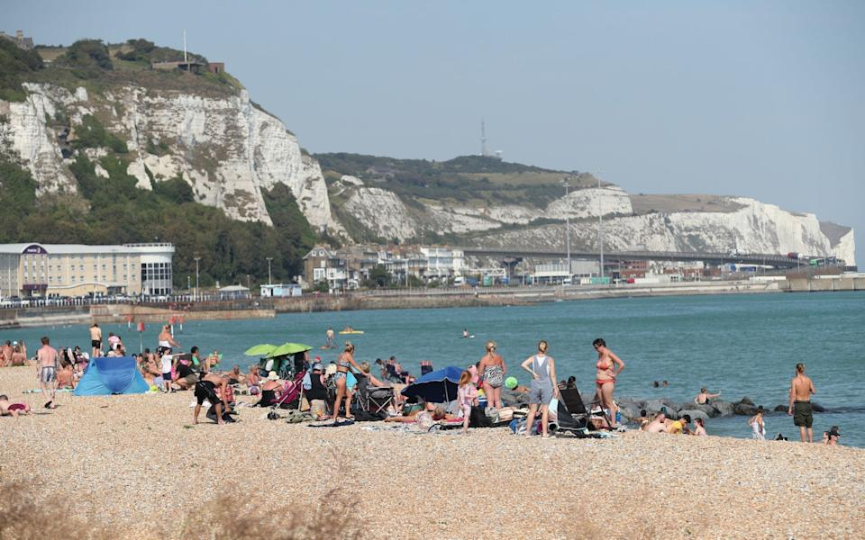 People enjoying the warm weather on a beach in Dover, Kent - Yui Mok/PA