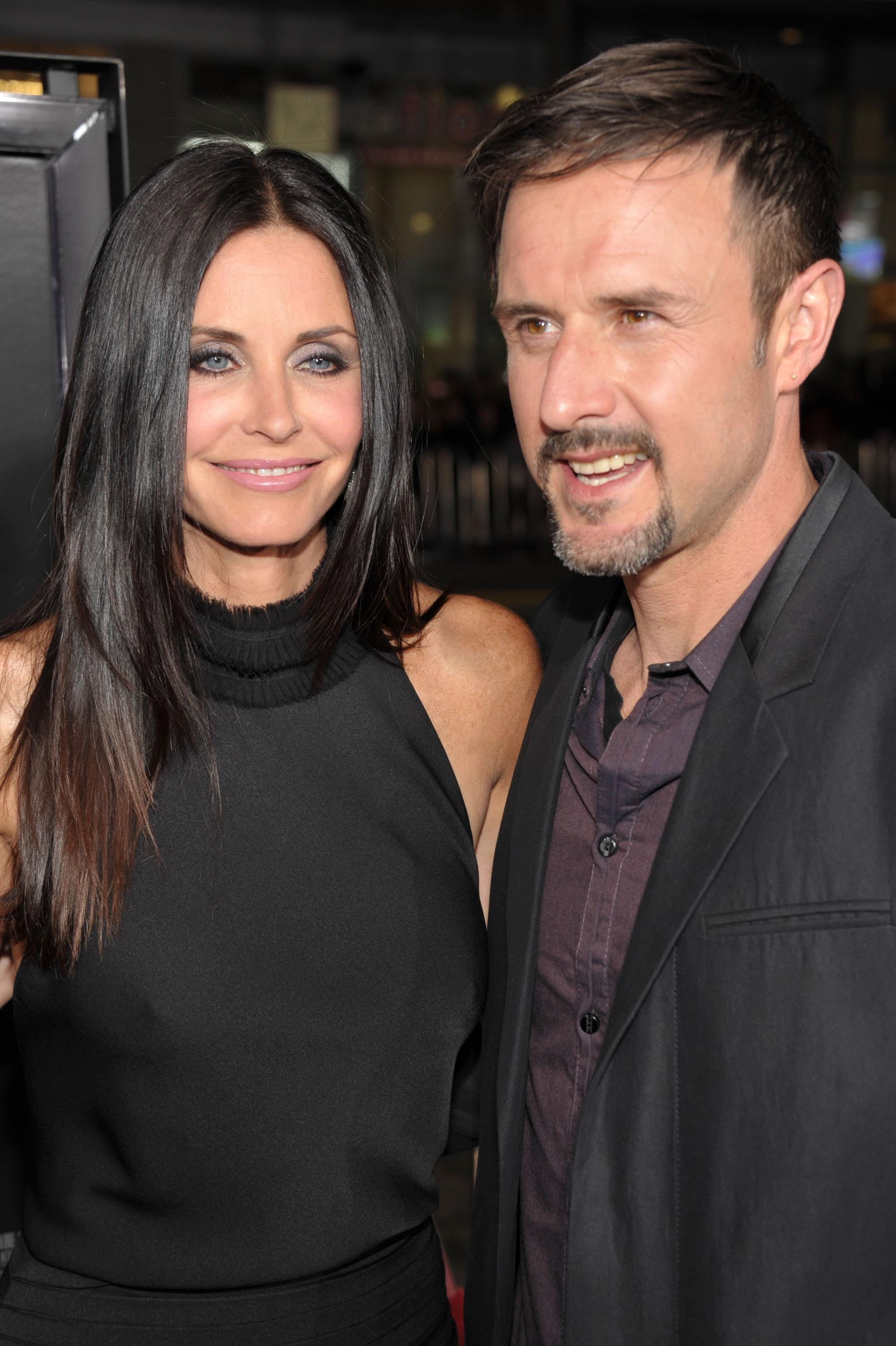 "Actors Courteney Cox and David Arquette arrive at the world premiere of The Weinstein Company's ""Scream 4"" presented by AXE Shower at Grauman's Chinese Theatre on April 11, 2011 in Hollywood, California."