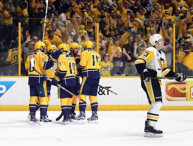 "NASHVILLE, TN – JUNE 03: <a class=""link rapid-noclick-resp"" href=""/nhl/players/4930/"" data-ylk=""slk:Roman Josi"">Roman Josi</a> #59 of the <a class=""link rapid-noclick-resp"" href=""/nhl/teams/nas/"" data-ylk=""slk:Nashville Predators"">Nashville Predators</a> celebrates with teammates after scoring a second period goal against <a class=""link rapid-noclick-resp"" href=""/nhl/players/5774/"" data-ylk=""slk:Matt Murray"">Matt Murray</a> #30 of the <a class=""link rapid-noclick-resp"" href=""/nhl/teams/pit/"" data-ylk=""slk:Pittsburgh Penguins"">Pittsburgh Penguins</a> (not pictured) in Game Three of the 2017 NHL Stanley Cup Final at the Bridgestone Arena on June 3, 2017 in Nashville, Tennessee. (Photo by Bruce Bennett/Getty Images)"