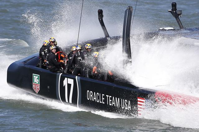 Oracle Team USA crosses the finish line ahead of Emirates Team New Zealandduring Race 18 of the 34th America's Cup yacht sailing race in San Francisco, California September 24, 2013. REUTERS/Stephen Lam (UNITED STATES - Tags: SPORT YACHTING)