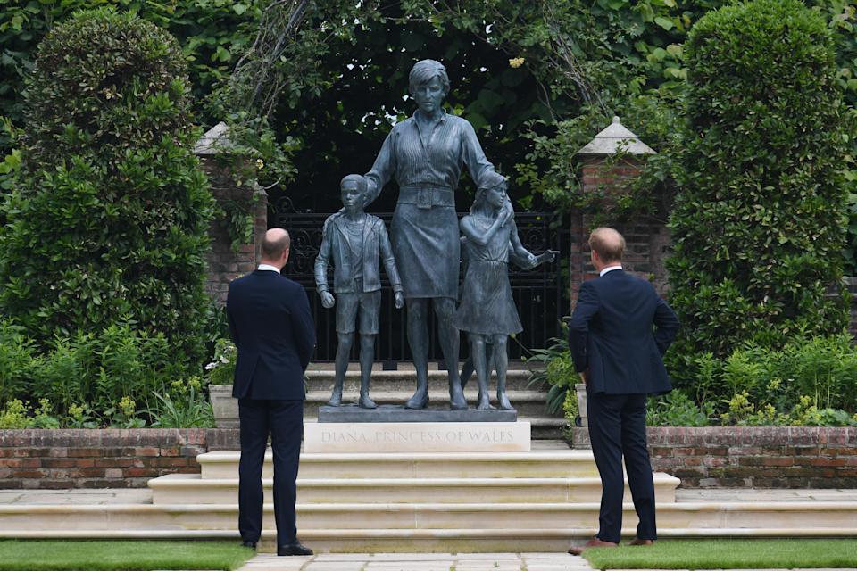 The Duke of Cambridge and Duke of Sussex look at the statue of their mother