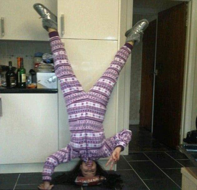 Imogen Thomas stood of her head in her new onesie after drinking a whole bottle of wine in the morning.