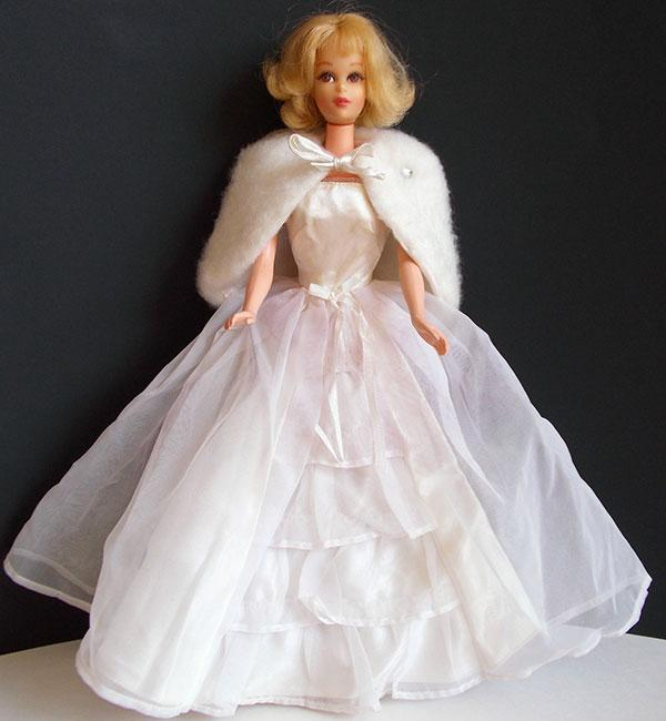 """<div class=""""caption-credit""""> Photo by: Ebay</div><div class=""""caption-title"""">1963: Barbie Wedding Bride's Dream</div>Sweet and feminine, this short-sleeved gown with a ruffled skirt is topped off with a fur cape. <br>"""