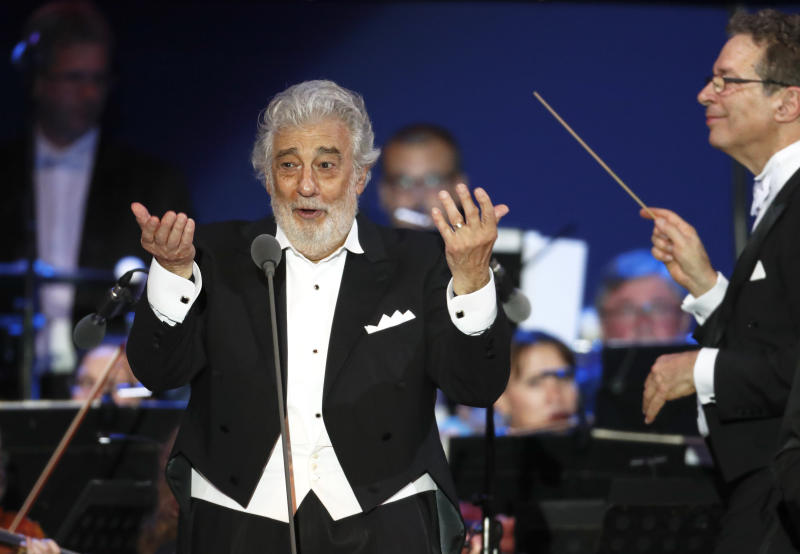 """FILE - In this file photo taken on Aug. 28, 2019, Opera star Placido Domingo performs during a concert in Szeged, Hungary. The 78-year-old singer who rose to stardom as a tenor has been confirmed to sing the baritone title role in """"Nabucco"""" at the Zurich Opera House this Sunday. It will be his first time performing since stepping down Oct. 2 as general director of the Los Angeles Opera and withdrawing from future performances at the company. (AP Photo/Laszlo Balogh)"""