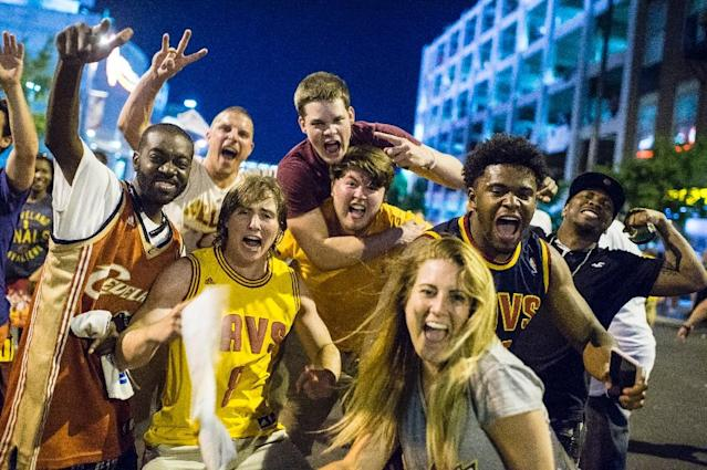 Cleveland Cavaliers fans celebrate after the Cavs defeated the Golden State Warriors to win the NBA Finals on June 19, 2016 (AFP Photo/Angelo Merendino)
