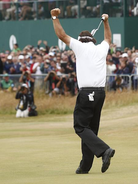 Phil Mickelson of the United States celebrates after his final putt on the 18th green during the final round of the British Open Golf Championship at Muirfield, Scotland, Sunday July 21, 2013. (AP Photo/Jon Super)