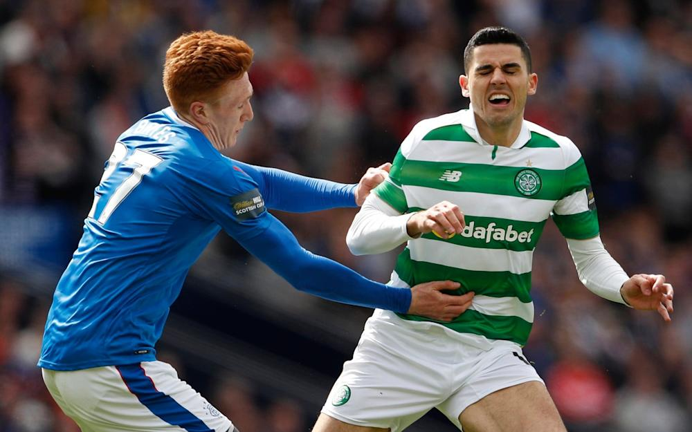 Rangers' Lee Hodson in action with Celtic's Tom Rogic earlier this season - Credit: REUTERS
