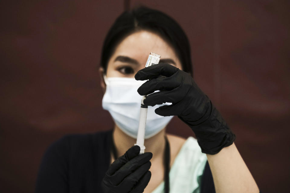 A pharmacist volunteer prepares doses of the Johnson and Johnson COVID-19 vaccine during a pop-up clinic at Western International High School on April 12, 2021 in Detroit, Michigan. (Matthew Hatcher/Getty Images)