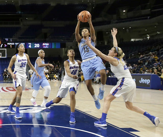 Marquette's Amani Wilborn (15) drives between DePaul's Amarah Coleman (10) and Kelly Campbell during the first half of an NCAA college basketball game in the championship of the Big East conference tournament, Tuesday, March 6, 2018, in Chicago. (AP Photo/Charles Rex Arbogast)