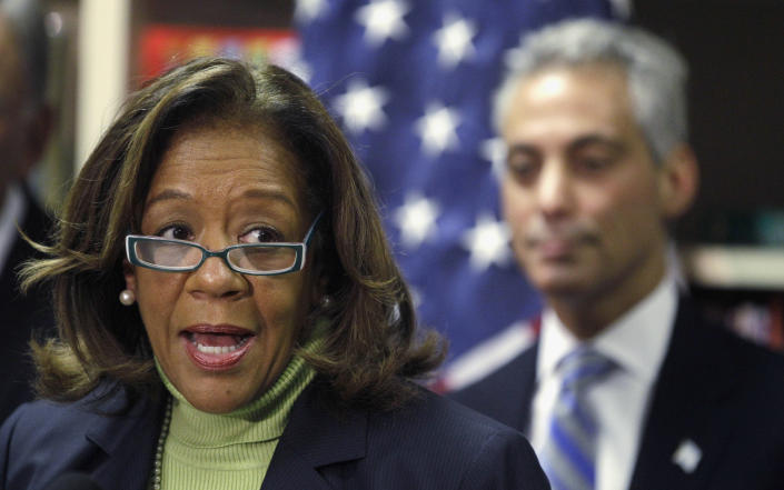 FILE - In this Oct. 12, 2012 file photo, newly appointed Chicago Public Schools CEO Barbara Byrd-Bennett speaks at a news conference in Chicago as Chicago Mayor Rahm Emanuel looks on. On Thursday, March 21, 2013, the city of Chicago began informing teachers, principals and local officials about which public schools it intends to close under a contentious plan that opponents say will disproportionately affect minority students in the nation's third largest school district. (AP Photo/M. Spencer Green, File)