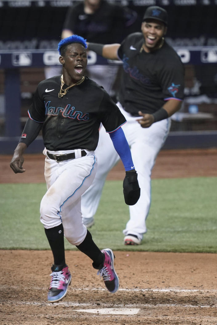 Miami Marlins' Jazz Chisholm Jr. (2) crosses home plate on a double by Jorge Alfaro for the winning run in the 10th inning against the San Francisco Giants in a baseball game Saturday, April 17, 2021, in Miami. The Marlins won 7-6. (AP Photo/Marta Lavandier)